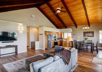 Open floor plan of living room, kitchen and dining area.