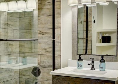 Bathroom with shower and sink.