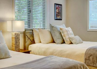 Twin beds in a bedroom.