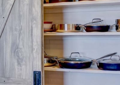 Pantry fill with pots and pans.