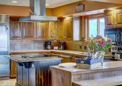 Fully appointed kitchen with large cooking hood.