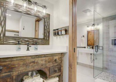 ADA compliant bathroom with walk in shower.